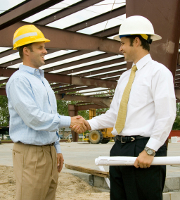 Image of Workers Shaking Hands
